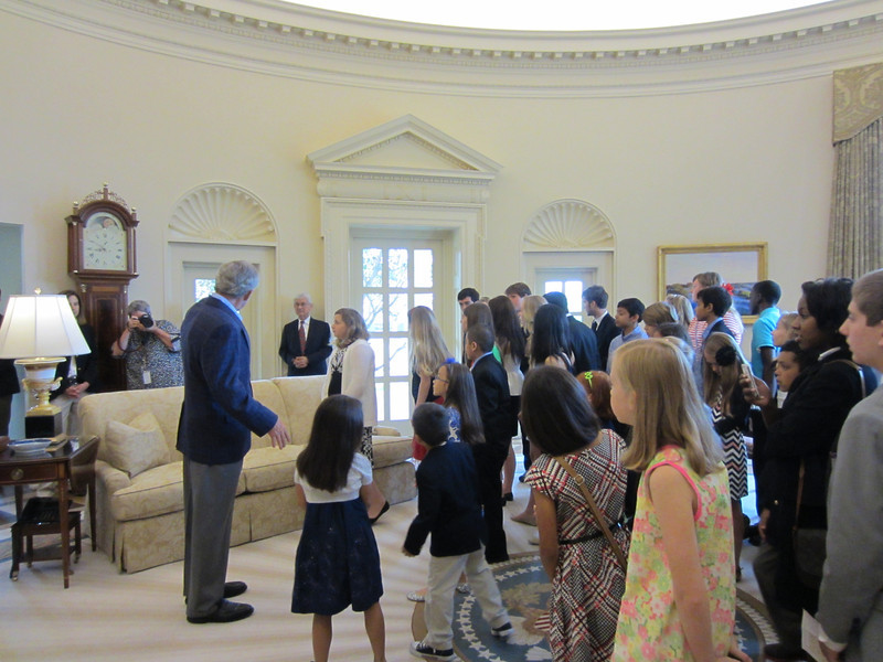 The former president shows the students around his Oval Office.