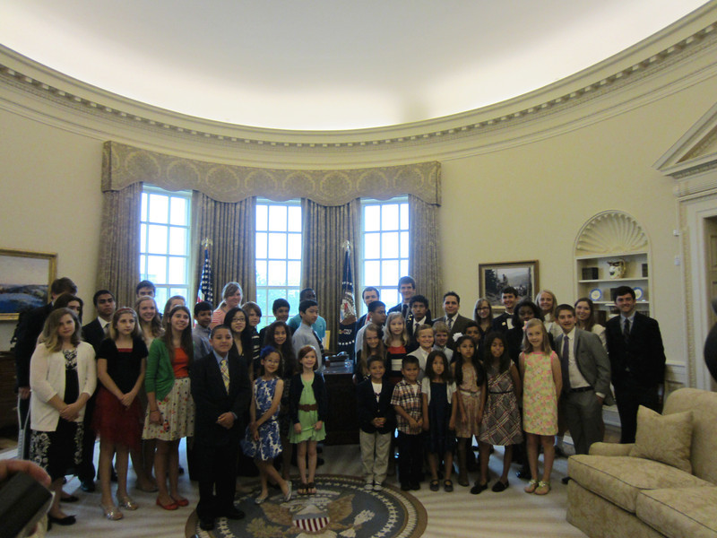 The group in the replica of the Oval Office.
