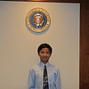Student in front of the Presidential Seal.
