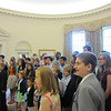 Visitors learn about the Oval Office.