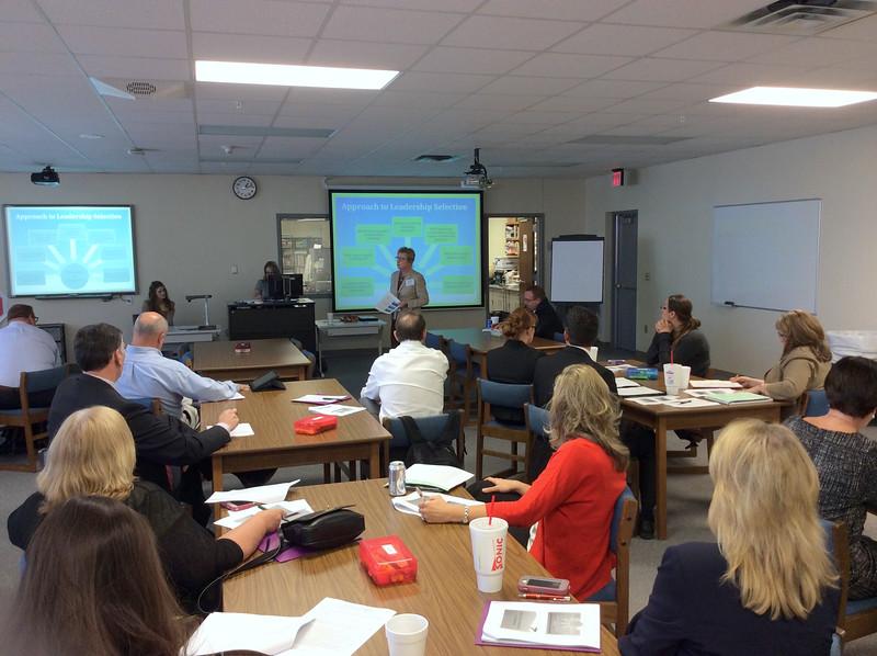 Superintendents listen to a presentation.
