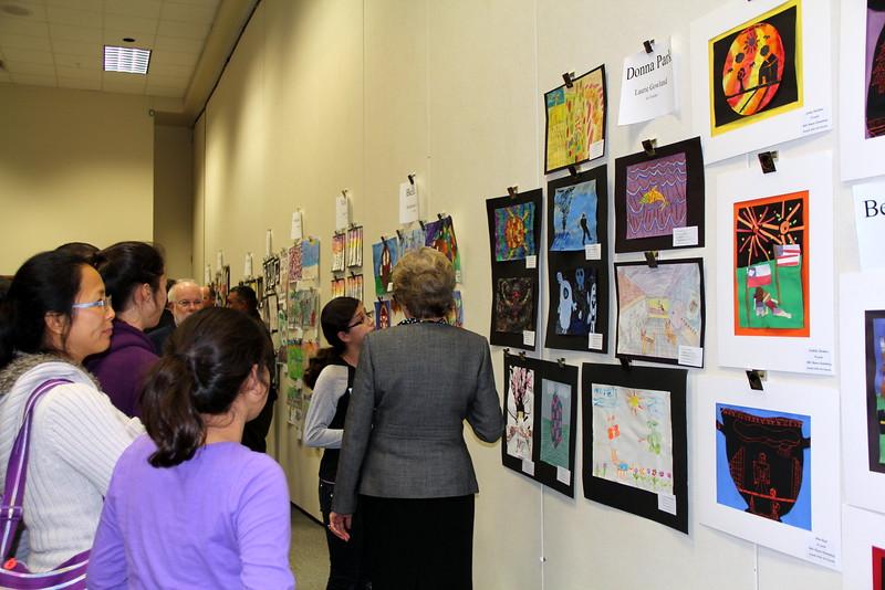 Visitors admiring the art.