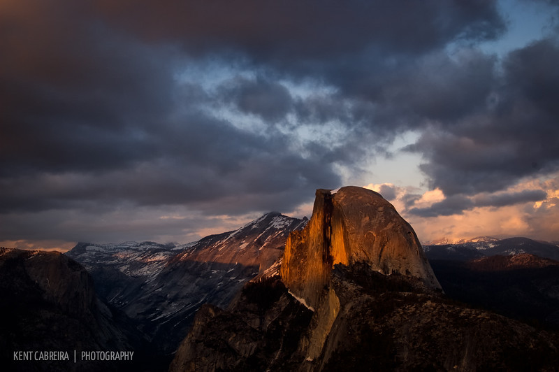 Clouds allow partial sunset lighting to fall across the face of Half Dome taken from Glacier Point in Yosemite National Park  • <i>Outdoor Photographer</i> magazine's 2009 <i>Your Favorite Places</i> contest finalist (1 of 2 finalist images out of 61 total images)
