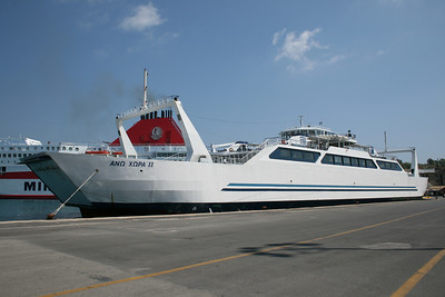 Open deck two-way ferry ANO CHORA II moored in Corfu. At bottom IKARUS PALACE.