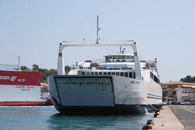 Open deck two-way ferry ANO CHORA II moored in Corfu. On side IKARUS PALACE.