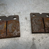 Old brake pads were in rough shape.<br /> New pads finish up the brake system overhaul.