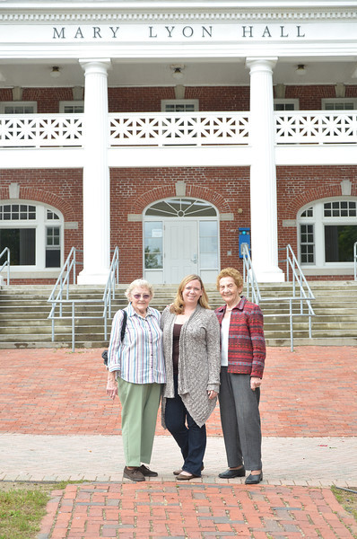 Agnes (Harrigan) Andross '47, Amy Ciaraldi '06, and Doris (Harrigan) Mosher '51 gather in front of Mary Lyon Hall for Family Legacy photo. Sisters Agnes and Doris celebrated Homecoming and Family Celebration 2012 with Amy, Doris's granddaughter.