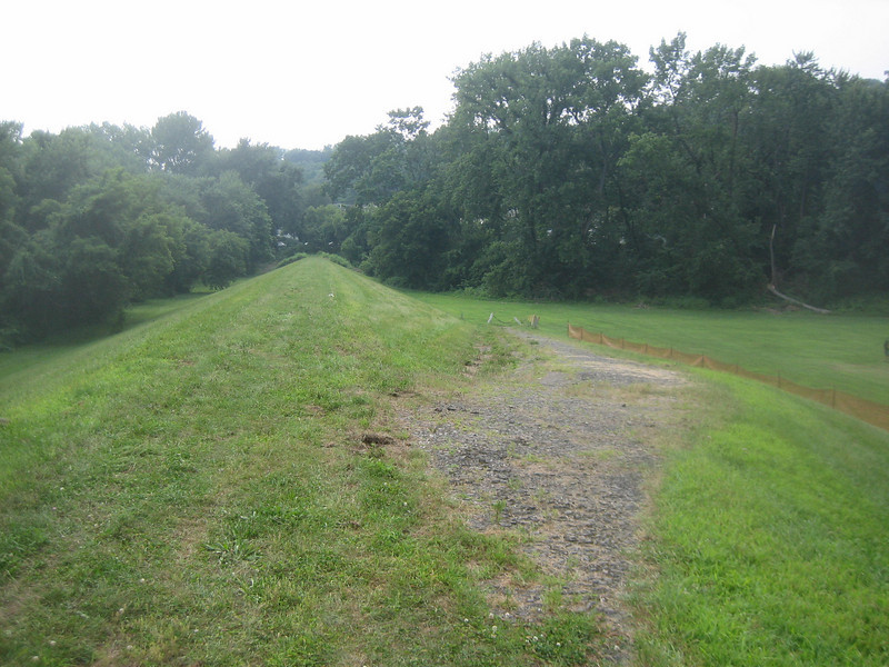 Another access path at the downstream end of the dike.  (In far distance is a tangle of brush and a No Trespassing sign at edge of private property.)