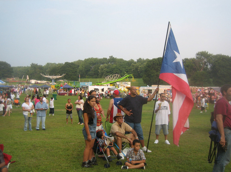 Another view of the Festival de la Familia in Springdale Park, Holyoke.  Note the trees and high ground in background. Let's go there to get out of the 95° heat and sun...