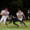 Fitchburg's Damien Nadal attempts to outrun Groton-Dunstable's Tim Stark during the game on Friday, October 20, 2017. SENTINEL & ENTERPRISE / Ashley Green