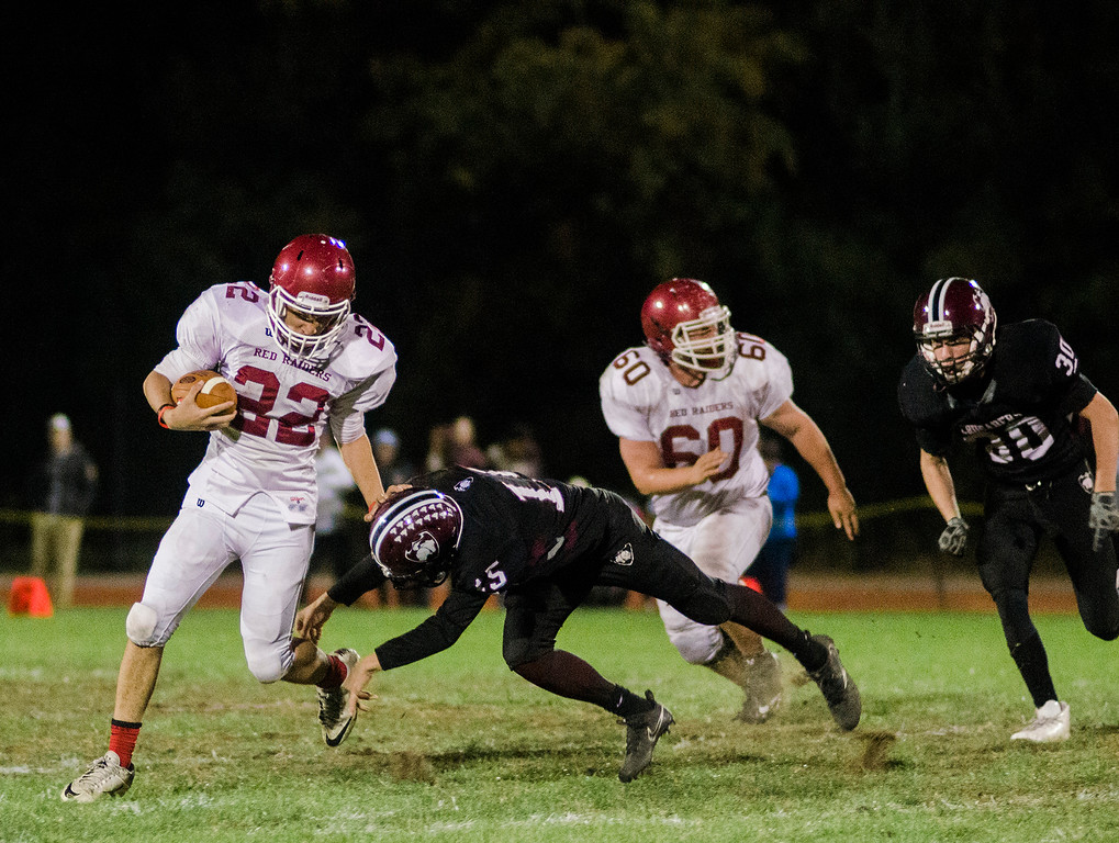 . Fitchburg\'s Damien Nadal attempts to outrun Groton-Dunstable\'s Tim Stark during the game on Friday, October 20, 2017. SENTINEL & ENTERPRISE / Ashley Green