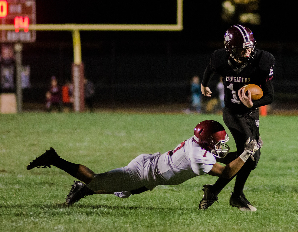 . Fitchburg\'s Angel Santiago brings down Groton-Dunstable\'s Bradley teDuits during the game on Friday, October 20, 2017. SENTINEL & ENTERPRISE / Ashley Green
