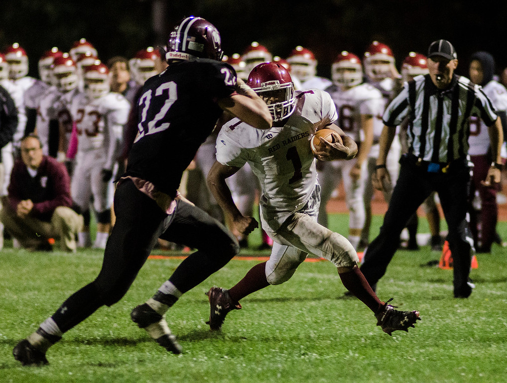 . Fitchburg\'s Sal Figueroa runs it in for a touchdown during the game against Groton-Dunstable on Friday, October 20, 2017. SENTINEL & ENTERPRISE / Ashley Green