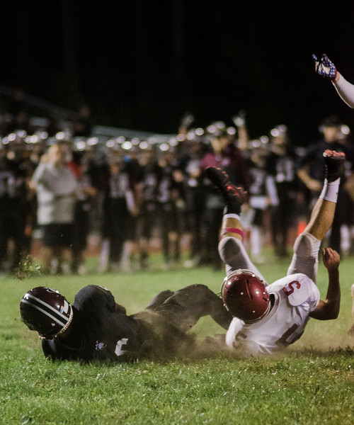 Groton-Dunstable's Jack Barry falls in for a touchdown during the game against Fitchburg on Friday, October 20, 2017. SENTINEL & ENTERPRISE / Ashley Green