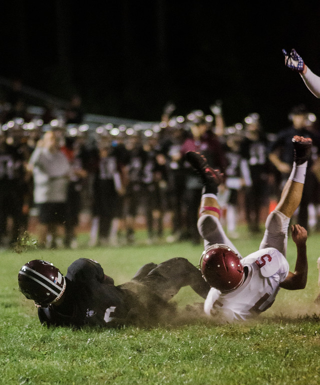 . Groton-Dunstable\'s Jack Barry falls in for a touchdown during the game against Fitchburg on Friday, October 20, 2017. SENTINEL & ENTERPRISE / Ashley Green