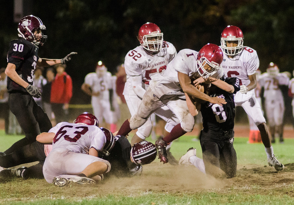 . Fitchburg\'s Sam Figueroa is brought down by Groton-Dunstable\'s Shamus Gelinas during the game on Friday, October 20, 2017. SENTINEL & ENTERPRISE / Ashley Green