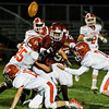 North Middlesex dives for the ball after being fumbled by Fitchburg's Sal Figueroa during the game on Friday, September 29, 2017. SENTINEL & ENTERPRISE / Ashley Green