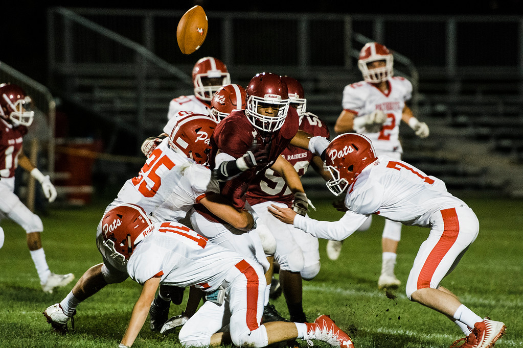 . North Middlesex dives for the ball after being fumbled by Fitchburg\'s Sal Figueroa during the game on Friday, September 29, 2017. SENTINEL & ENTERPRISE / Ashley Green