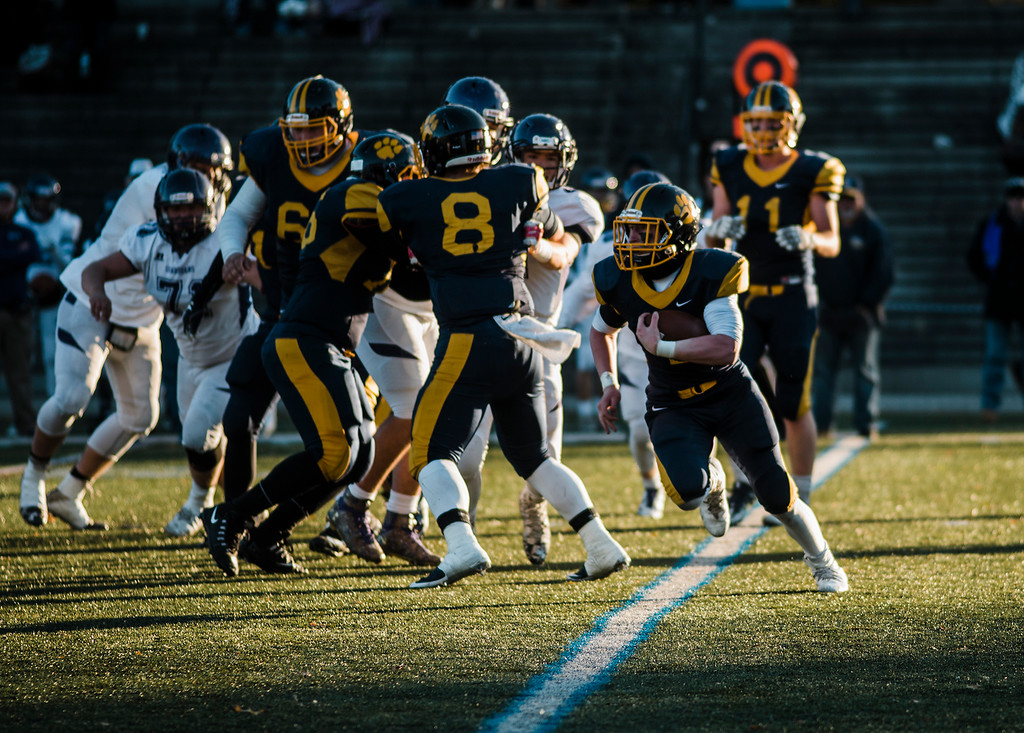 . Littleton\'s Kevin Frisoli runs the ball during the Central Mass D6 championship against St. Peter-Marian on Saturday, November 11, 2017. Littleton\'s victory puts them into the Super Bowl, to be held at Gillette Stadium in December. SENTINEL & ENTERPRISE / Ashley Green