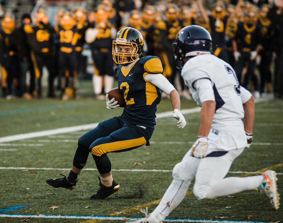 . Littleton\'s Bradley Klock runs the ball during the Central Mass D6 championship against St. Peter-Marian on Saturday, November 11, 2017. Littleton\'s victory puts them into the Super Bowl, to be held at Gillette Stadium in December. SENTINEL & ENTERPRISE / Ashley Green