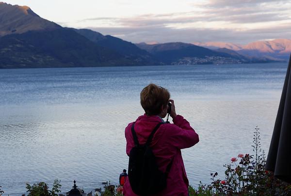 Ann taking photos at sunset