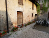 Borgo San Donino, back at the agriturismo, the sun sets on the courtyard outside the rooms