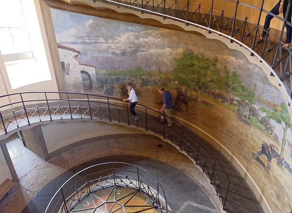 Tower of San Martino della Battaglia; Lucy and Jim - mostly ramps and landings with a few stairs; the murals depict the wars of Italy as a nation