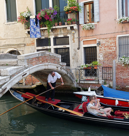 Venice; original style bridge without rails, high tide requires one to watch one's head