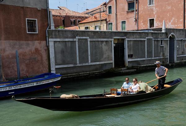 Venice; ersatz gondolier (poor copy of boat, not standing on stern, etc)