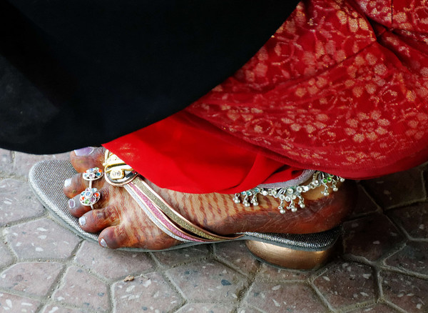 Woman's foot - a sect that does extensive foot and hand coloring, Agra Railway Station