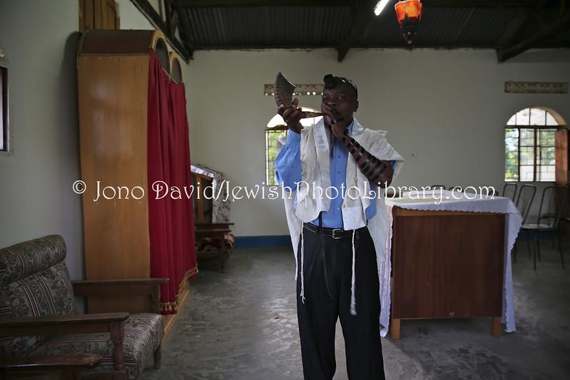 UG 504  Abayudaya Jews  Seth Yonadav practices the shofar  Moses Synagogue, Nabugoye Village, Mbale, Uganda