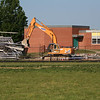 Long range view of bleachers and backhoe.