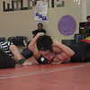 Alejandro Izales works a pinning combination against his Wheaton opponent.
