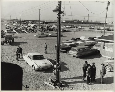 Car Lot with Auto Trailer on Milwaukee Road Flat Cars