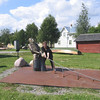 In Piteå, Eva assists the stationary fisherman in pulling in his netted catch.
