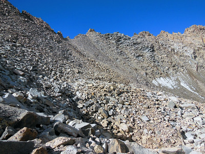 Looking up the eastside of the Haeckel-Wallace Col.  Route crosses boulder field to the lowest point right of the small outcrop visible left of center.