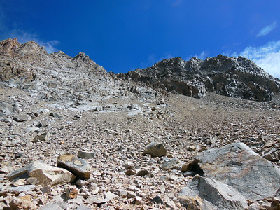 The west-side descent scree slope of the Haeckel-Wallace Col.  Mt Wallace on the right.