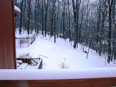 Our back yard and lower deck from the side, with my garden covered in snow.
