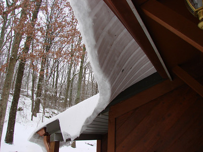 Uh Oh.  That metal roof and sliding snow ...