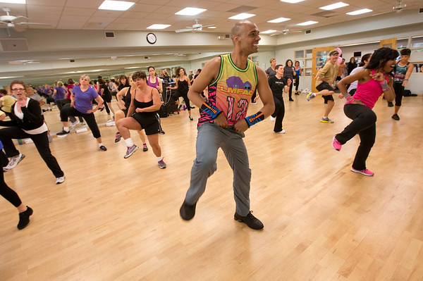 """Billy Blanks Jr. and wife Sharon Catherine Blanks demonstrate """"Dance it Out"""" for a group of fans at HNH Fitness in Oradell, NJ.   6/3/13  Photo by Jeff Rhode/Holy Name Medical Center"""