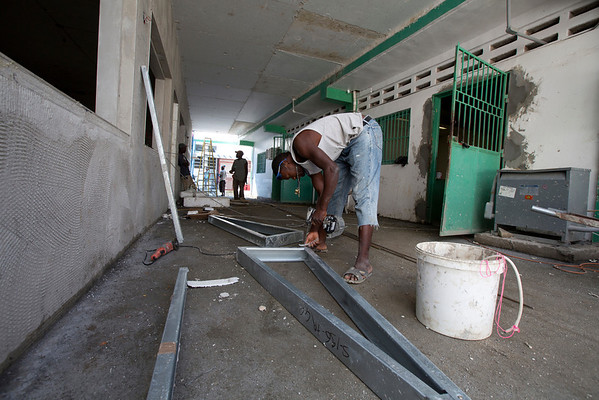 Construction on the new employee cafeteria building at Hopital Sacré Coeur in Milot, Haiti. A U.S. company was contracted to build the structure and employed almost all Haitian labor. <br /> Photos from Hopital Sacré Coeur, the CRUDEM foundation, and Holy Name Medical Center's involvement in Milot, Haiti.  Photo by Jeff Rhode / Holy Name Medical Center 3/13/13