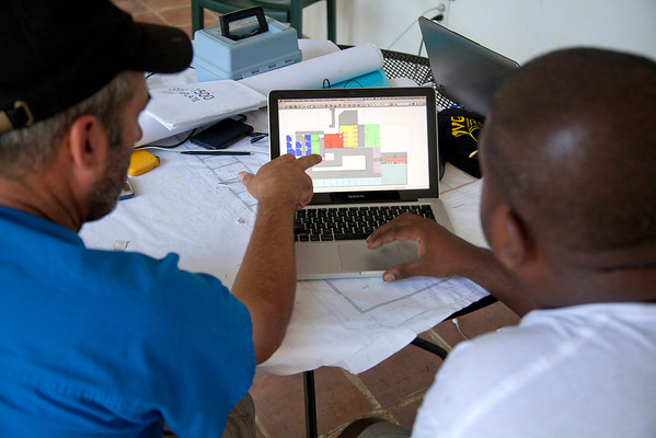 Steve Mosser goes over plans for new construction at Crusem in Milot, Haiti. <br /> Photos from Hopital Sacré Coeur, the CRUDEM foundation, and Holy Name Medical Center's involvement in Milot, Haiti.  Photo by Jeff Rhode / Holy Name Medical Center 10/21/13