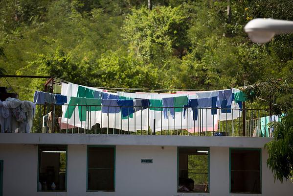 The hospital laundry is dried outside Hopital Sacré Coeur in Milot, Haiti. <br /> Photos from Hopital Sacré Coeur, the CRUDEM foundation, and Holy Name Medical Center's involvement in Milot, Haiti.  Photo by Jeff Rhode / Holy Name Medical Center 9/7/12