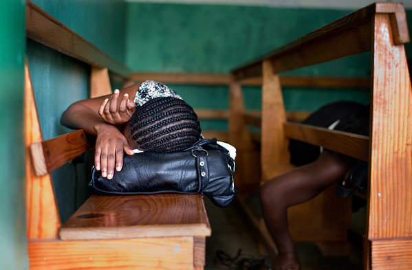 A woman sleeping on a bench at Hopital Sacre Coeur in Milot, Haiti. It is not uncommon for people to travel for days to get to the hospital. Photos from Hopital Sacré Coeur, the CRUDEM foundation, and Holy Name Medical Center's involvement in Milot, Haiti.  Photo by Jeff Rhode / Holy Name Medical Center 6/12/12