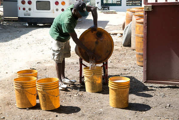 Diesel fuel is transferred from large drums to 5 gallon buckets at Hopital Sacré Coeur in Milot, Haiti.<br /> <br /> Photos from Hopital Sacré Coeur, the CRUDEM foundation, and Holy Name Medical Center's involvement in Milot, Haiti.  Photo by Jeff Rhode / Holy Name Medical Center 9/5/12