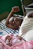 A woman with her newborn baby in Hopital Sacré Coeur in Milot, Haiti. <br /> Photos from Hopital Sacré Coeur, the CRUDEM foundation, and Holy Name Medical Center's involvement in Milot, Haiti.  Photo by Jeff Rhode / Holy Name Medical Center 6/13/12