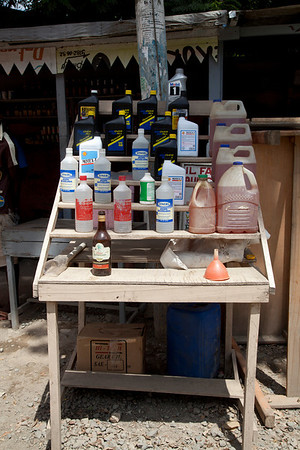 Local color and the people of Milot, Haiti. <br /> Petroleum is sold on the side of the road in refilled containers. <br /> Photos from Hopital Sacré Coeur, the CRUDEM foundation, and Holy Name Medical Center's involvement in Milot, Haiti.  Photo by Jeff Rhode / Holy Name Medical Center 9/6/12