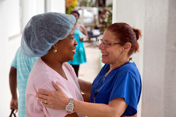 Dr. Judith Kutzleb of Holy Name Medical Center greets a Haitian friend and coworker at Hopital Sacre Coeur in Milot, Haiti.<br />  Photos from Hopital Sacré Coeur, the CRUDEM foundation, and Holy Name Medical Center's involvement in Milot, Haiti.  Photo by Jeff Rhode / Holy Name Medical Center 10/24/13
