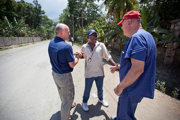 Mike Maron and Dr. Dave Butler are greeted by a Haitian man on the street in Milot, Haiti. <br /> Photos from Hopital Sacré Coeur, the CRUDEM foundation, and Holy Name Medical Center's involvement in Milot, Haiti.  Photo by Jeff Rhode / Holy Name Medical Center 6/12/12