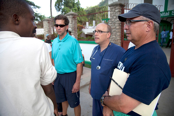 A crew of administration arrives in Milot, Haiti from Holy Name Medical Center in Teaneck, NJ. <br /> Dr. Previl, CEO of Hopital Sacre Coeur, meets outside the hospital with Joe Lemaire, Adam Jarrett, and Ted Carnevale.<br /> Photos from Hopital Sacré Coeur, the CRUDEM foundation, and Holy Name Medical Center's involvement in Milot, Haiti.  Photo by Jeff Rhode / Holy Name Medical Center 10/29/12